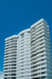 white apartment-building poster