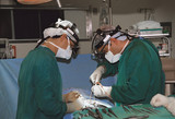 two surgeons operating poster
