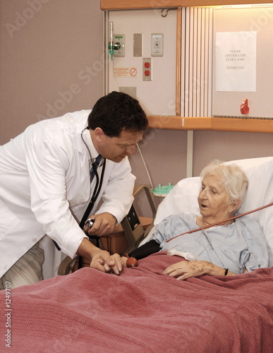 attending to senior woman in hospice