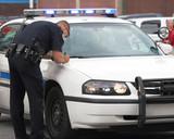 policeman making report poster