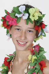 preteen girl dressed as hula girl