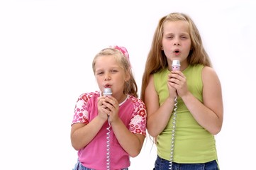 singing girls with microphones