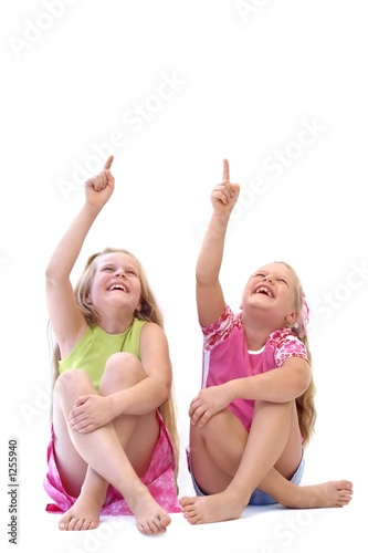 two girls pointing (at your advertisement?)