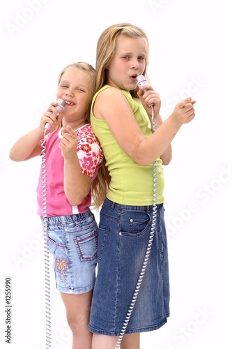 two girls singing