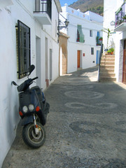 parked scooter in village street