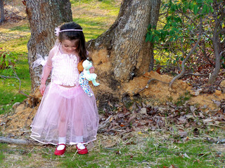 princess girl looking at dorothy shoes