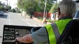 an elderly man driving a bus.driving bus/transport poster