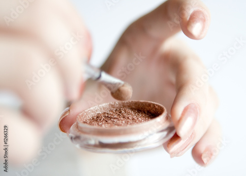 beige eyeshadow in hands