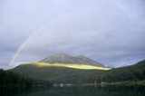 rainbow over the alces lake in the break of dawn poster