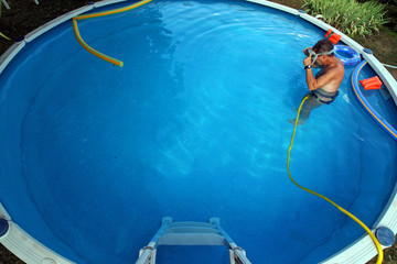 man cleaning swimmimg pool