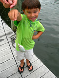 boy catching first fish poster