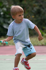 boy catching tennis ball