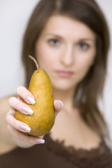 girl posing holding pear