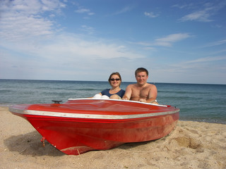 couple in red motorboat