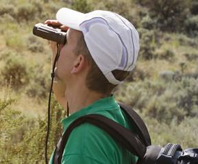man with a field glass birdwatching