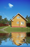 Fototapety wooden house reflecting in the water