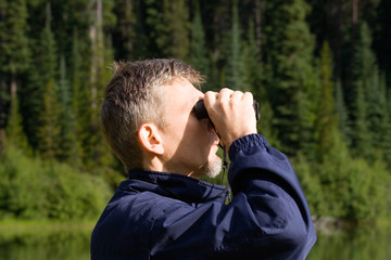 park ranger watching closely wildlife