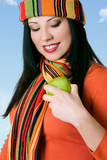 attractive female shining a fresh apple poster