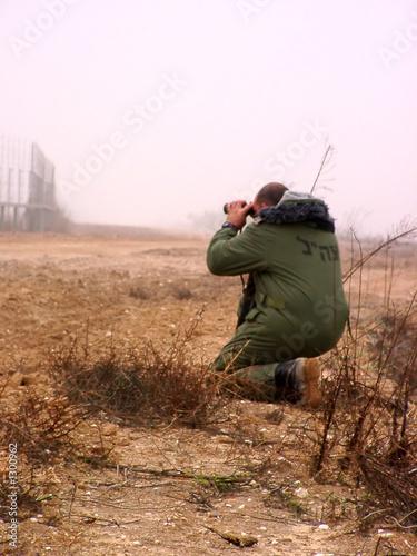 israeli officer near gaza strip border poster