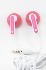 pink earbuds closeup, macro