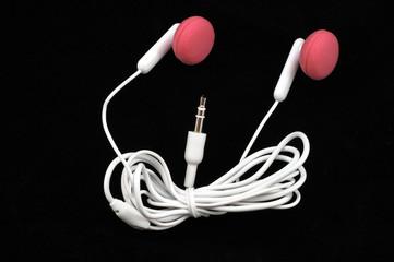 pink earbuds black background