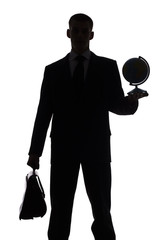 silhouette of man with suitcase and globe