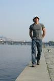man walking along the embankment poster