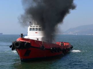 smoking tugboat