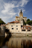 historic buildings on a tranquil river poster