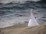 bride on the edge  of ocean poster