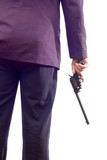 person in a suit holding a gun poster