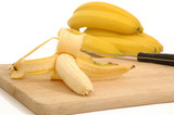 bananas on a carving board