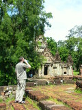 tourist in cambodia temples - angkor wat poster