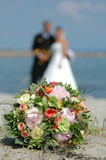 bouquet, bride and groom. focus on the bouquet. poster