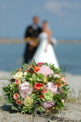 bouquet, bride and groom. focus on the bouquet.