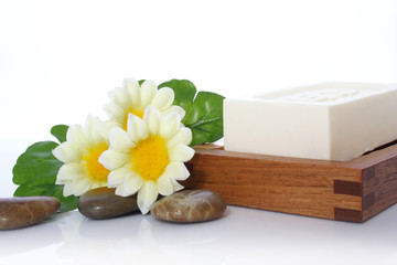 soap, flower and river stone