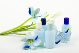 blue composition: cosmetics with flower poster
