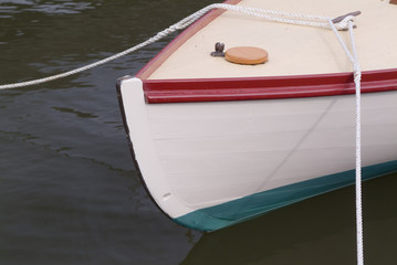 sailboat tied to dock on chesapeake bay