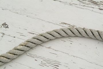 sailboat rigging rope on old faded deck