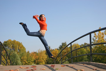 jump girl on autumn bridge