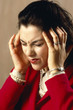 woman with headache under stress