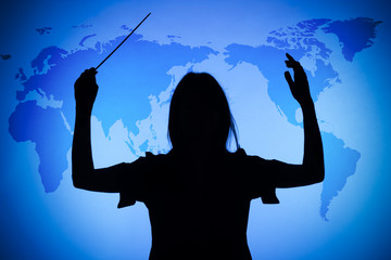 silhouette of female conductor on the world map