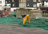 fisherman repairing nets poster