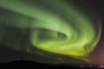 aurora swirls over town