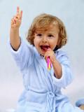 happy girl brushing teeth poster