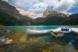 aluminum canoe and a boat poster