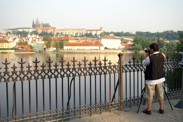 photographer shots a view to prague castle