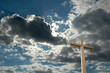 cross against bright clouds