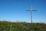 rustic cross over blue sky poster