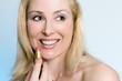 beauty - happy female applying pink lipstick